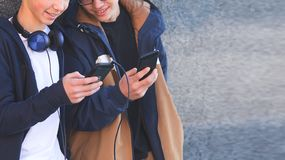 Close up of teenagers using their phones royalty free stock photography