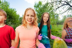 Close-up of teens with gloves and garbage bags Stock Photography
