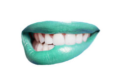 Close-up of teeth biting colored lip over white background Royalty Free Stock Photos
