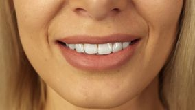 Close-up of teeth and lips of beautiful girl royalty free stock photos