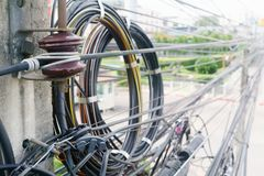 Close up of  telecommunication wires attached to the electric po Royalty Free Stock Image