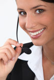 Close up of a telephonist. Close up of a smiling telephonist Stock Photography