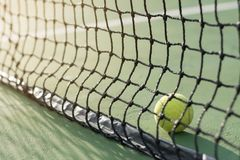 Tennis ball back to net Royalty Free Stock Image