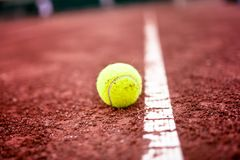 Close-up of tennis ball on the clay court Stock Photos