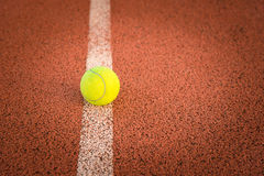 Close up of tennis ball on clay court./Tennis ball Royalty Free Stock Photo