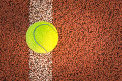 Close up of tennis ball on clay court./Tennis ball Royalty Free Stock Image