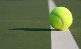 Close up of a tennis ball on the court Royalty Free Stock Photography