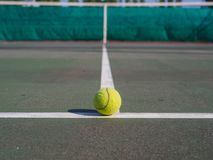 Close up of tennis ball on the court. Sport active concept. royalty free stock photography