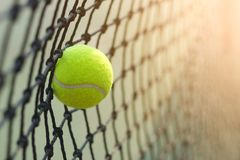 Close up tennis ball hitting to net on blur. Background Royalty Free Stock Images
