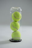 Close up of tennis ball in plastic bottle Royalty Free Stock Photography