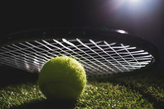 Close up of tennis ball with racket Royalty Free Stock Photos