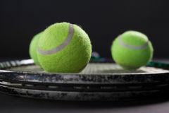 Close up of tennis balls on racket Royalty Free Stock Images