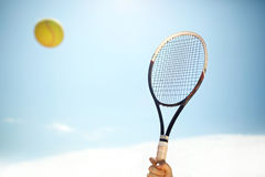 Close up of tennis racket and ball in action Stock Photography