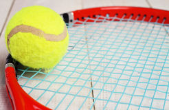 Close up on tennis racket and ball. Sport equipment background, wallpaper Stock Photos