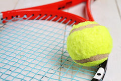 Close up on tennis racket and ball. Sport equipment background, wallpaper Stock Image