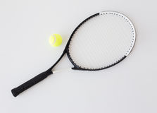 Close up of tennis racket with ball Royalty Free Stock Photos