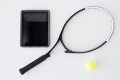 Close up of tennis racket with ball and tablet pc Stock Photography
