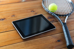 Close up of tennis racket with ball and tablet pc Stock Photos