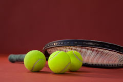 Close up of tennis racket on balls Stock Image