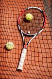 Close up tennis racket and balls. On red dross stock photography