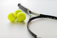 Close up of tennis racket with balls Stock Photos