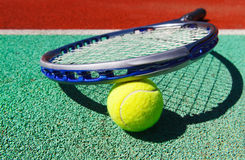 Close up of tennis racquet and ball. On the clay tennis court Stock Image