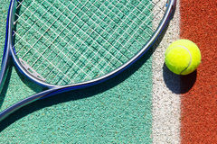 Close up of tennis racquet and ball. On the clay tennis court Royalty Free Stock Photo