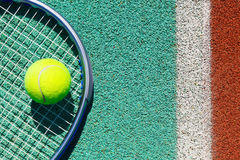 Close up of tennis racquet and ball on the tennis court Royalty Free Stock Images
