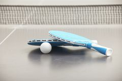 Close-up of tennis rockets. Blue rockets for tennis lying on gray table with small white ball Stock Photo