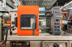 Close-up termoplástico da máquina da modelação por injeção fotos de stock royalty free