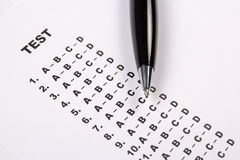 Close up of test score sheet with answers and pen. Close up of test score sheet with answers and metal pen Royalty Free Stock Photos