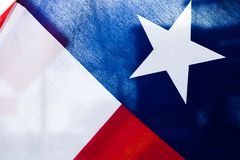 Close up of Texas flag with light coming through royalty free stock image
