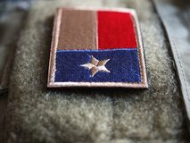 Close-up of Texas Flag Velcro Patch. Texas Flag Patch On The Bulletproof Plate Carrier, Shallow Depth Of Field stock photo