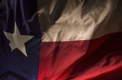 Lone Star. Close up of the Texas state flag filling the entire frame with the red white and blue fields and single star Royalty Free Stock Photo
