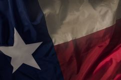 Lone Star. Close up of the Texas state flag filling the entire frame with the red white and blue fields and single star Stock Images