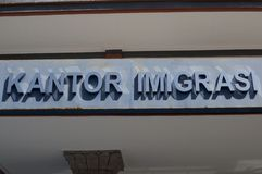 Close up of the text Kantor Imigrasi Immigration Office of Denpasar, Bali stock image