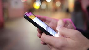 A Close Up of Texting or Emailing on Smart Phone in a City Street stock footage