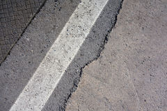 Asphalt road Close-up. Close-up texture of an asphalt road with marking Stock Photography