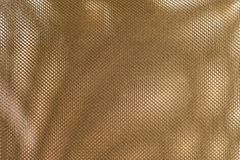Close Up Texture Background of Bronze Polyester Fabric. Fabric Texture, Close Up of Bronze Polyester Nylon of Office Chair to Created A Textured Background Royalty Free Stock Photo
