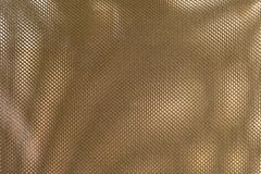 Close Up Texture Background of Bronze Polyester Fabric Royalty Free Stock Image