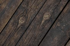 Close up texture background of old dark wooden boards obliquely arranged in a floor stock image