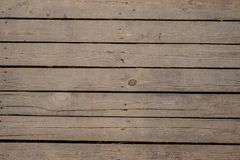 Close up texture background of old unpainted wooden boards arranged in a wall. Close up texture background of old unpainted wooden boards horizontally arranged Stock Photos