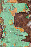Close Up texture of Chipped peeling green paint over rust, cover Royalty Free Stock Photography
