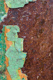 Close Up texture of Chipped peeling green paint over rust, cover Royalty Free Stock Image
