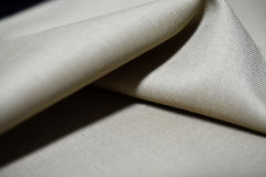 Close up texture cream color fabric of suit Royalty Free Stock Images