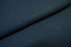 Close up texture dark blue fabric with stripe line of suit Stock Photography