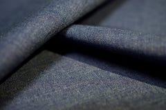 Close up texture dark purple blue fabric of suit Stock Photo
