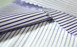 Close up texture fabric thin purple line and white of shirt. Photo shoot by depth of field for object Stock Photo