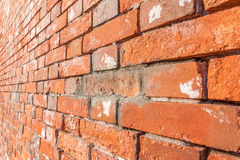 Close up texture of grungy red brick wall background. Royalty Free Stock Images