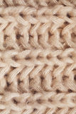 Close up texture of knitted beige scarf Royalty Free Stock Images